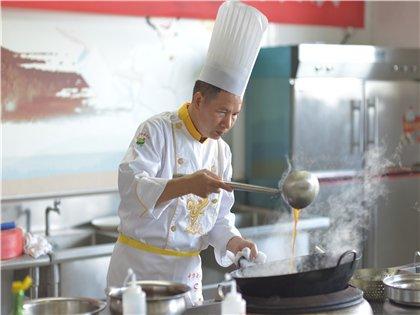 广西商业高级技工学校开展中国烹饪大师进校园活动